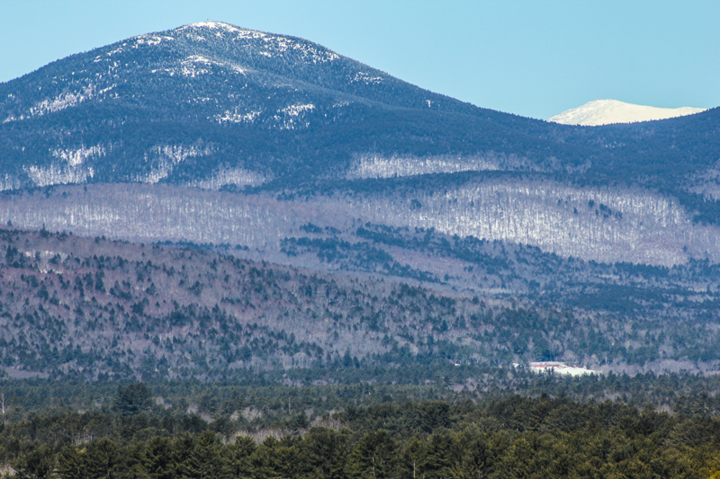 The white snow covered mountain is Mt. Washington in New Hampshire.